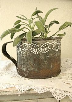 painted rusty cup planted with sage