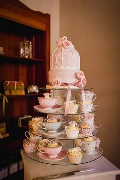 Tea Party Wedding Cupcake Tower. See more here: Pearls and Lace Pink Love Birds Wedding at Langkloof Roses | Confetti Daydreams ♥  ♥  ♥ LIKE US ON FB: www.facebook.com/confettidaydreams  ♥  ♥  ♥ #Wedding #RealBride #RealWedding #Pink