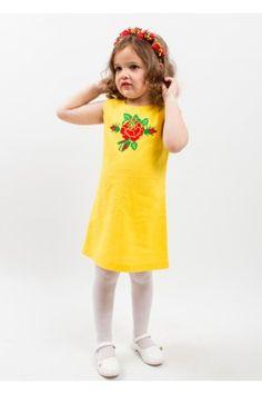 a7f899d2033a23 Яскраво-жовта вишита сукня, в якій ваша принцеса буде схожою на промінчик  сонця. Вишита на сукні троянда робить вбрання оригінальним та стильним.