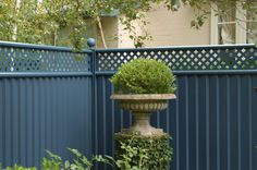 Colourfence works in all architectural settings. We have a fencing system will create a great background to your special garden environment.