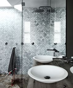 """""""We spent up on our main ensuite, as this is a room where you spend lots of time relaxing,"""" says Heidi. """"Carrara fan-shaped tiles (huge splurge) and a solid-stone freestanding bath give instant luxe."""""""