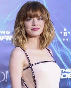 Wavy Hairstyle with Blunt Bangs by Emma Stone