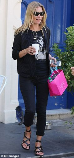 Cool and casual: The supermodel teamed black cropped skinnies with a silky bomber jacket f...