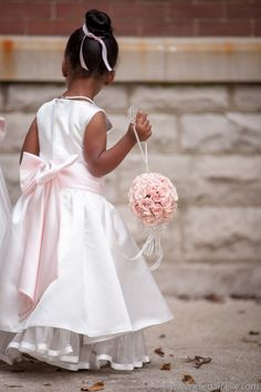 Flower girl carries a pomander ball of light pink spray roses to accent her dress | by Dorothy McDaniel's Flower Market, Elle Danielle Photography