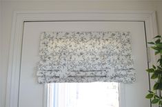 French Door Curtain in brand new fabric and we are loving it! Cream with black flower pattern. Flip it (as seen in picture). Roll it. Fold it. Fast and easy installation with no hardware needed.