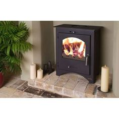 Stove shop, budget stoves, cheap wood burning, multi fuel stoves from Glasgow Stove Centre Scotland, Glasgow fireplace showroom Cast Iron Fireplace, Fireplace Wall, Log Burner Living Room, Fireplace Showroom, Multi Fuel Stove, Wood Burner, Hearth, Great Rooms, Small Spaces