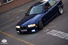 Dark blue BMW e36 sedan on BBS RS wheels