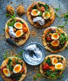 Pittas with dukkah-coated quail eggs, chickpea and chorizo salad and mint yoghurt dressing