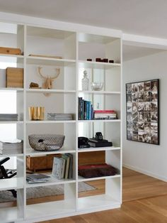 Bookshelves separating maybe living room from dining room or kitchen.