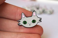 Enamel cat lapel pin - Enamel pin  Created from my original grey fluffy cat face illustration, these super cute enamel pins are perfect for any