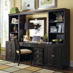 Interesting Home Office Unit With Custom Storage And Showcase Wall