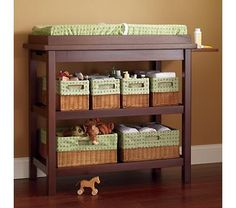 wood furniture with soft woven baskets - line baskets with material to match crib bedding etc.Dark wood furniture with soft woven baskets - line baskets with material to match crib bedding etc. Baby Changing Station, Baby Changing Tables, Changing Table Organization, Diy Organization, Dark Wood Furniture, Baby Furniture, Baby Changer, Brown Crib, Ideas Habitaciones
