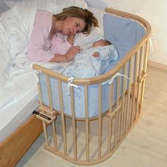 """Bedside Cradle - Genius idea!  I wonder if women are beginning to design baby cribs??  This is called an """"arm sleeper"""".  Info available at www.armsreach.com"""
