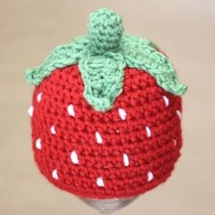 Yummy and sweet! This crochet strawberry hat would make a wonderful spring/summer accessory and an adorable photo prop. Free pattern!