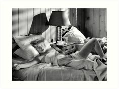 """Marilyn Monroe – He Is At The Door / In the 1953 film, """"Niagara,"""" a young Marilyn Monroe is seen early in the movie, alone, lying in a motel room bed, smoking a cigarette, when her husband returns to the room.  This photographic fantasy portrays Marilyn's reaction to hearing the sound of the motel room door's lock being opened. / This fantasy vision is not an actual photograph from the production of the film, nor is it a publicity ph..."""