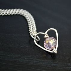 Make up a sweet handmade Valentine's gift with a few inches of wire, a bead, and a chain!
