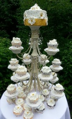 Cupcake Stand made from a chandilier for a Anniversary Garden Party Cake And Cupcake Stand, Cupcake Party, Cupcake Cakes, Cake Stand Decor, Wedding Sweets, Wedding Cupcakes, 50th Wedding Anniversary, Anniversary Parties, Diy Party Decorations