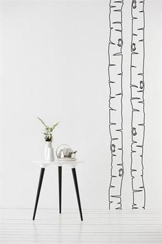 Nice design idea for wall paint. Love the table and drawing combination.