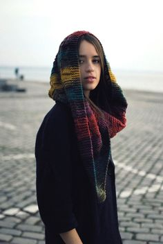 A warm and colorful hood scarf.