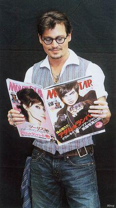 Johnny Depp reading magazine with Adam Lambert on the cover... <3