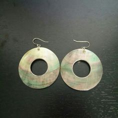 Black mother of pearl disk earrings Gently used. Silver trim and post. Banana Republic Jewelry Earrings