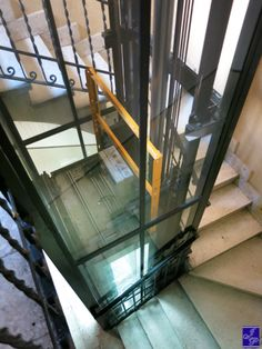 Exterior glass lift or elevator is a nice way to get down for Hillside elevator cost