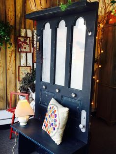 Gorgeous Hall tree made out of an old door! A great addition to you entry way or mud room! Hand Painted Black with touches of white and grey throughout to give it that old feel!