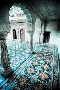 Through tiled riads.