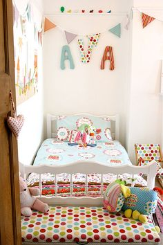 PERFECT!!! everything she wants in 1... Little girl's bedroom.  So cute!  Love the fabrics and colors.