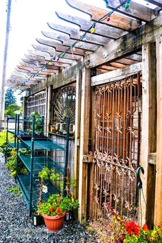 Upcycled sections of a garden shed  / Reclaimed garden features at a Hope garden centre via http://www.funkyjunkinteriors.net/