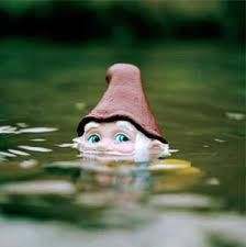 Gnomie is looking for his shoes in the lake, no thanks to the mischievous Trolls. Tricky Trolls liked to play catch with shoes. HIS shoes. Of course the Trolls missed their toss and kerplunk. Down down to the bottom  they went.  aaagh...