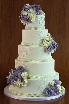 amazing wedding cakes Inspired by the Gown. Add floral appliques that coordinate with the pattern on your dress. Planning on wearing pearls Trim each layer with a candy version. Purple Wedding Cakes, Amazing Wedding Cakes, Elegant Wedding Cakes, Wedding Cake Designs, Amazing Cakes, Elegant Cakes, Gorgeous Cakes, Pretty Cakes, Bolo Fack