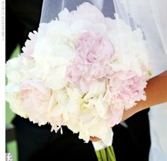 The bride carried a bouquet of white hydrangeas, blush pink peonies, and pink dendrobium orchids.