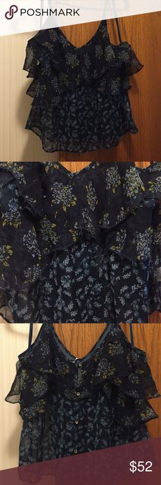 """NWT Free People All Things Tank Black. A button front tank in a breezy, tiered design. V neck, sleeveless, adjustable tank straps. Shell is 100% viscose. Lining is 100% rayon. All over print; overlay detail at chest. Hits above the hip. Fits size 8-10. Bust 37""""-38"""". Not from a smoke free house. Free People Tops Tank Tops"""