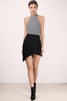 85d95531746f You got to catch up with the Caught Up Wrap Mini Skirt. Featuring a front