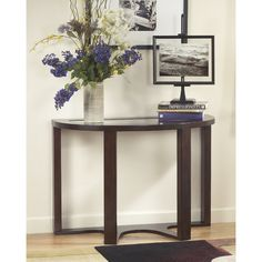 When done just right, simplicity can be simply striking—as is the case with this sofa table. Clean lines give it a great sense of ease, while a dark finish exudes rich character. A glass insert on the tabletop keeps the look airy and open while scalloped detailing rounds out this contemporary look.
