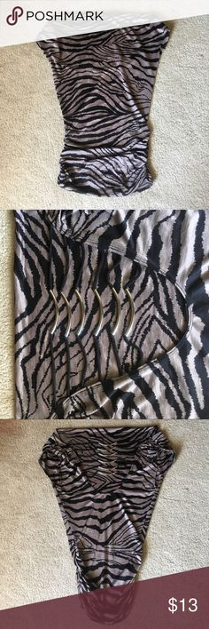 Open back zebra print shirt Loose fit up top and snug fit on bottom Tops