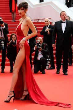 18 May Bella Hadid showed off plenty of skin in a strappy red dress with a thigh-high split as she debuted a new fringe, which may have been a clip-on. - HarpersBAZAAR.co.uk