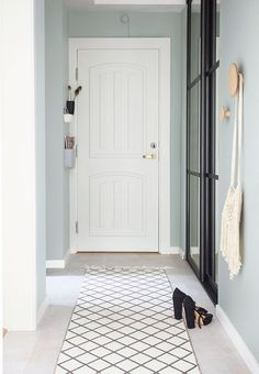 Simple and nice entryway with mint-green walls that gives an airy expression.