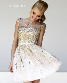 This short, white Sherri Hill prom dress is so scrumptiously pretty. It looks like it has been sprinkled with with liquid gold!