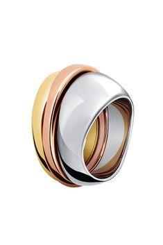 Triple anillo de acero inoxidable y oro, de CK.