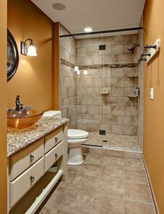 Craftsman 3/4 Bathroom with Raised panel, Flush, partial backsplash, Wall sconce, Shower, can lights, stone tile floors