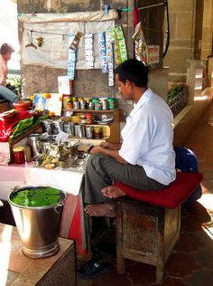 "Preparing Betel and Lime  Street stall worker preparing betel nut and lime packets along the ""mall"" area of Colaba, Mumbai, India    copyright Tammy Winand  Available as prints on request...msg me here or see links in my profile"