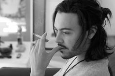 Jack Huston smoking a cigarette (or weed)