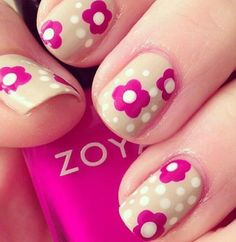 Beige nails with hot pink flowers and white dots