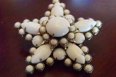 SOLD : This Milk Glass Brooch is a beautiful piece of 1940s Fashion Jewelry, a Christmas Snowflake pin of vintage Milk Glass and Gold Tone metal. This