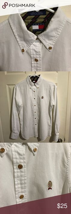 Tommy Hilfiger Awesome Shirt Awesome Tommy Hilfiger Button Down! Shirt is in flawless condition. Awesome white shirt with gold buttons, and awesome interesting patterns. Real Head Turner! Size 6. Believe it was made for women but still works on men as well. Great deal for this shirt! Tommy Hilfiger Tops Button Down Shirts