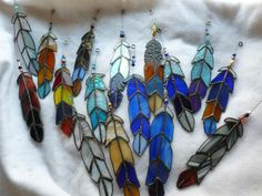 the latest crop  Indian Chief  Eagle Feather  stained glass with Beads. $21.50, via Etsy.