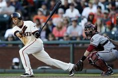 San Francisco Giants' Marco Scutaro, left, drives in the game-winning run with a single against the Arizona Diamondbacks during the 10th inning of a baseball game, Monday, Sept. 3, 2012, in San Francisco. San Francisco won 9-8.