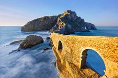 San Juan de Gaztelugatxe Climb across the bridge and up the 241 steps to the top of San Juan de Gaztelugatxe — a must-see when visiting Basque Country in Spain. When you reach the church at the top, ring the bell Places In Spain, Places To See, San Pedro, Destinations, Basque Country, Spain And Portugal, Spain Travel, Rafting, Nature Photos